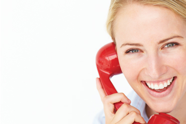 Woman using a red telephone