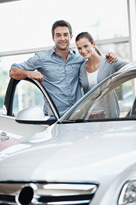 Couple with a newly purchased car